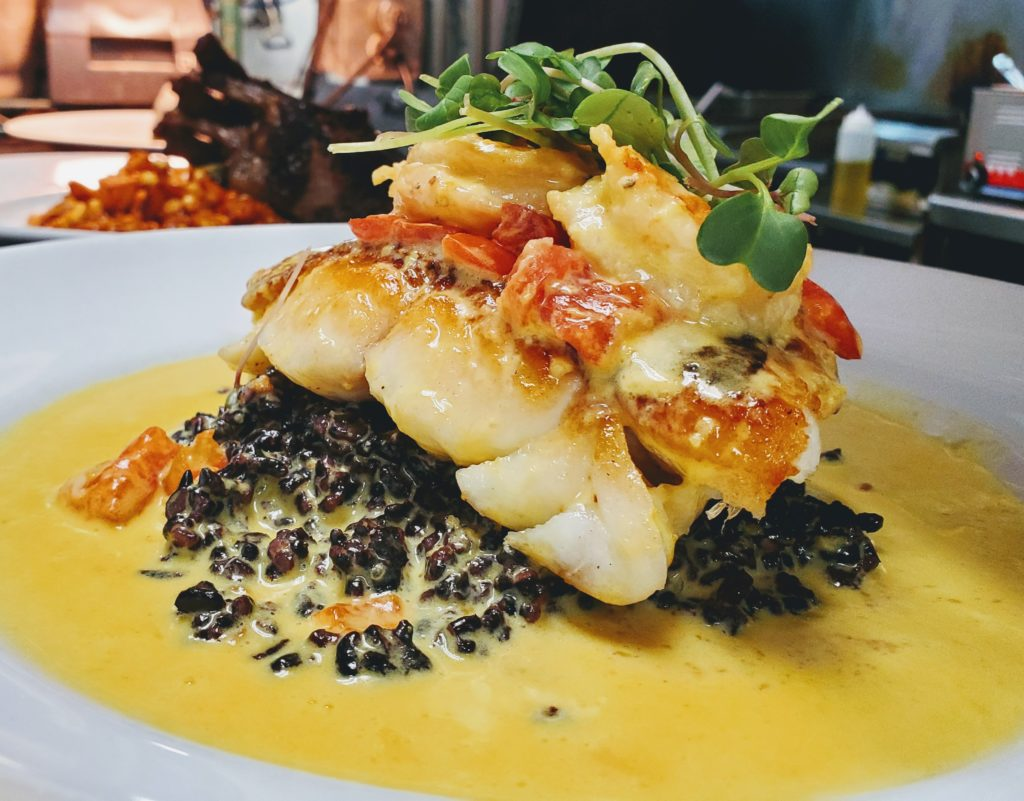 Pan Seared Local Grouper , Black Forbidden Rice, Saffron and Preserved Lemon Beurre Blanc, Local Butter Poached Shrimp, Micro Greens