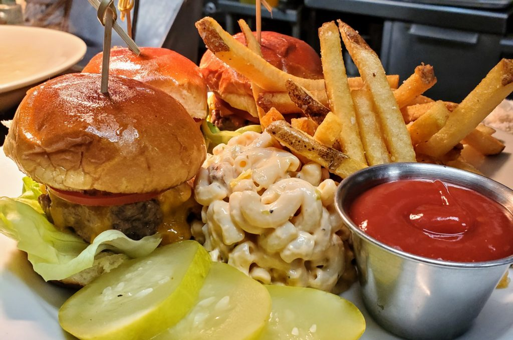 Lunch Menu - Dry Aged Beef Sliders, Brioche Bun, Aged Cheddar, Bacon, Macaroni Salad with Bacon and Tomato Dressing, Twice Fried Duck Fat Fries.